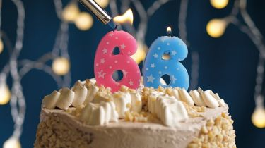 Birthday cake with 66 number candle © Getty Images/iStockphoto