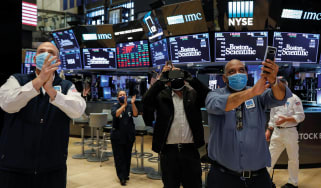 Trader on the floor of the New York Stock Exchange ©Alamy