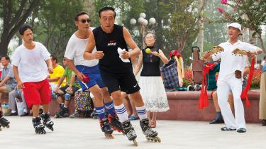 People rollerblading in a park in China
