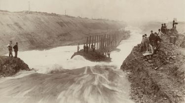 Engineers letting in water to the Manchester Ship Canal at Ellesmere Port
