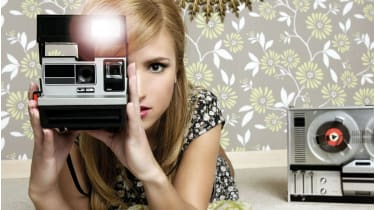 Woman with a Polaroid camera © Getty Images/iStockphoto