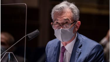 Jerome Powell in a face mask © Tasos Katopodis/Getty Images